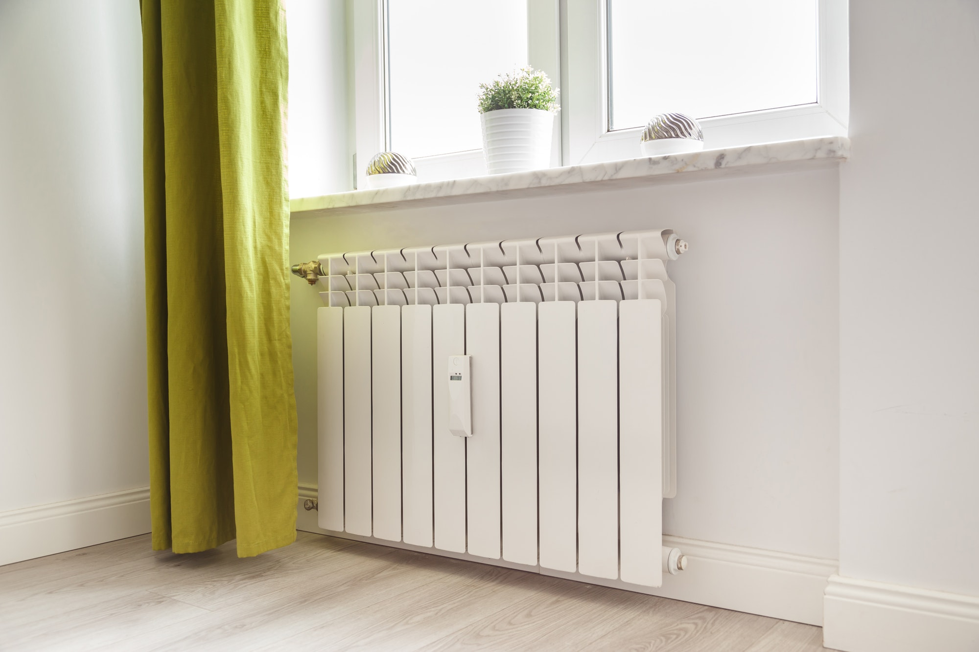Heating white radiator radiator in living room.